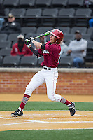 Trent Bryan (23) of the Harvard Crimson follows through on his swing against the Wake Forest Demon Deacons at David F. Couch Ballpark on March 5, 2016 in Winston-Salem, North Carolina.  The Crimson defeated the Demon Deacons 6-3.  (Brian Westerholt/Four Seam Images)