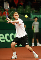 10-2-06, Netherlands, tennis, Amsterdam, Daviscup.Netherlands Russia,  Dmitry Tursonov in action against Raemon Sluiter.