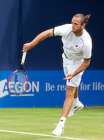 Xavier Malisse (BEL) against Dimitry Tursunov (RUS) in the first round of the men's singles. Malisse won the first set 6-2...Tennis - ATP World Tour - AEGON Championships - Queen's Club - London - Day 2 - Tues 08 Jun 2010..© AMN Images - Level 1, Barry House, 20-22 Worple Road, London, SW19 4DH.Tel - +44 (0) 208 947 0100.email - mfrey@advantagemedianet.com. www.photoshelter.com/c/amnimages.