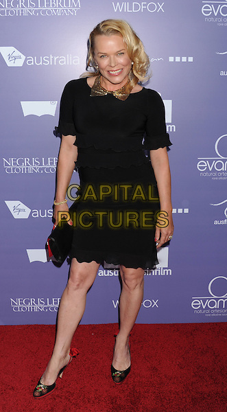 Kym Wilson.arriving at the 8th Annual Australians In Film Breakthrough Awards & Benefit Dinner at InterContinental Hotel in Century City, California, USA,.June 27th 2012. .full length black dress ruffle .CAP/ROT/TM.©TM/Roth Stock/Capital Pictures