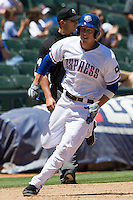 Round Rock outfielder Jim Adduci (24) rounds third base as he sprints home against the Nashville Sounds in the Pacific Coast League baseball game on May 5, 2013 at the Dell Diamond in Round Rock, Texas. Round Rock defeated Nashville 5-1. (Andrew Woolley/Four Seam Images).