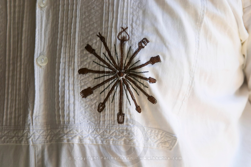 Detail of man's shirt in traditional Albanian style with the symbol of the restaurant embroidered. Tradita traditional restaurant, Shkodra. Albania, Balkan, Europe.