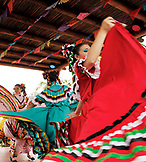 USA, California, San Diego, several members of Grupo Folklorico colorfully dance at the Fiesta de Reyes in Old Town