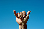 Hawaii: Kauai, shaka hand sign.  Photo hifree143.Photo copyright Lee Foster, 510/549-2202, lee@fostertravel.com, www.fostertravel.com