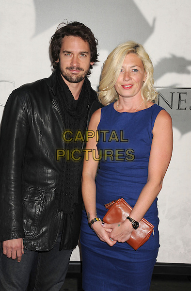 """Will Kemp, Kate Ashford.""""Game Of Thrones"""" 3rd Season Los Angeles Premiere held at the TCL Chinese Theatre, Hollywood, California, USA..March 18th, 2013.half length jacket blue dress sleeveless clutch bag brown black leather jacket scarf beard facial hair.CAP/ROT/TM.©Tony Michaels/Roth Stock/Capital Pictures"""