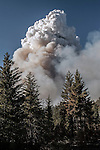 Cloud of smoke rises over Crane Flat Helitack Base.