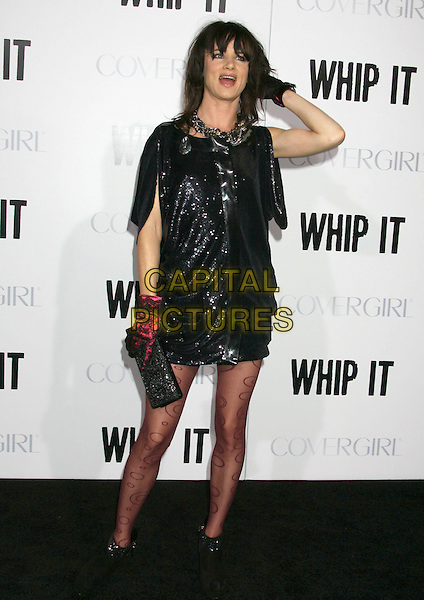 "JULIETTE LEWIS.""Whip It"" Los Angeles Premiere held At Grauman's Chinese Theatre, Hollywood, California, USA..September 29th, 2009.full length black blue sequined sequin shiny dress patterned tights pink lace gloves ankle boots clutch bag mouth open hand on head in hair .CAP/ADM/MJ.©Michael Jade/AdMedia/Capital Pictures."