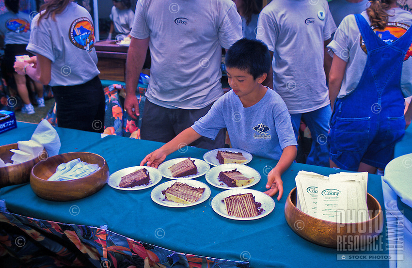 """Food, fun and entertainment at the """"""""taste of Honolulu festival"""""""". Young boy with pieces of cake"""