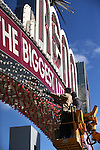 Austin Martin and Luke Smith, with American Sign & Crane Service, replace 2,100 white bulbs in the Reno Arch with new red bulbs on Friday, Jan. 31, 2014. The change, in place for the month of February, is to raise awareness about heart disease and recognize American Heart Month. (Las Vegas Review-Journal/Cathleen Allison)