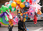 16 June 2013, Kabul University, Kabul Province,  Afghanistan. A balloon seller on the streets of Kabul. Picture by Graham Crouch/World Bank