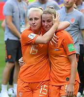20190707 - LYON , FRANCE : Dutch Inessa Kaagman pictured comforting disappointed and dejected Jackie Groenen after losing the female soccer game between The United States of America – USA-  and the Netherlands – Oranje Leeuwinnen -, the final  of the FIFA Women's  World Championship in France 2019, Sunday 7 th July 2019 at the Stade de Lyon  Stadium in Lyon  , France .  PHOTO SPORTPIX.BE | DAVID CATRY
