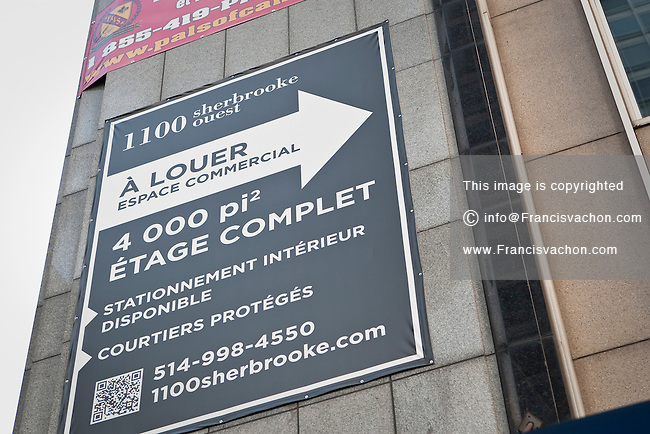 """A """"For rent"""" sign for a downtown commercial space is pictured in Montreal Thursday October 25, 2012."""