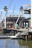 Pearl Harbor Memorial Bridge, New Haven Harbor Crossing Corridor, Interstate 95 in CT. Construction of Connecticut Department of Transportation Contract B as seen on September 9, 2011. New Northbound Span, Progress of the Replacement Bridge. When complete this will be the first Extradosed Bridge in the United States. This view includes Traveling Formwork, Quinnipiac River, Western Towers and platforms.