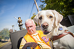 Lions Club Member with seeing eye dog companion at the Columbus Day Parade