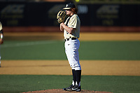 Wake Forest Demon Deacons starting pitcher Colin Peluse (8) looks to his catcher for the sign against the Gardner-Webb Runnin' Bulldogs at David F. Couch Ballpark on February 18, 2018 in  Winston-Salem, North Carolina. The Demon Deacons defeated the Runnin' Bulldogs 8-4 in game one of a double-header.  (Brian Westerholt/Four Seam Images)