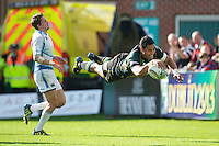 George Pisi of Northampton Saints dives over in dramatic style to score a try during the Heineken Cup match between Northampton Saints and Glasgow Warriors  at Franklin's Gardens on Sunday 14th October 2012 (Photo by Rob Munro)