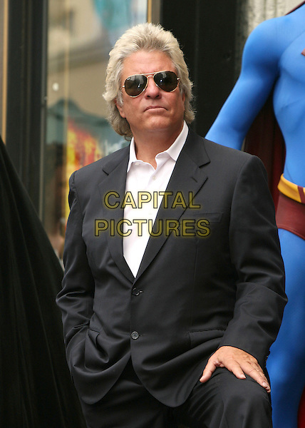 JON PETERS.Producer Jon Peters Honored with a Star on the Hollywood Walk of Fame in front of Grauman's Chinese Theatre, Hollywood, California, USA,.1 May 2007..half length sunglasses sut hand on knee john.CAP/ADM/BP.©Byron Purvis/AdMedia/Capital Pictures.