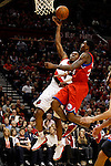12/26/11--Trail Blazers reserve guard Nolan Smith drives 76ers' Louis Williams for a layup in the season-opener at the Rose Garden...Photo by Jaime Valdez. .....................................