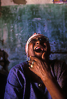 Toothless elderly black woman laughes, Pernambuco, northeastern  Brazil.