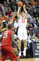 Virginia guard Joe Harris (12) shoots a three point basket over Maryland forward Jonathan Graham (25) during the game Monday night in Charlottesville, VA. Photo/The Daily Progress/Andrew Shurtleff