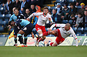 Stacy Long and Michael Bostwick of Stevenage set up  an attack. - Wycombe Wanderers v Stevenage - Adams Park, High Wycombe - 31st December 2011  .© Kevin Coleman 2011