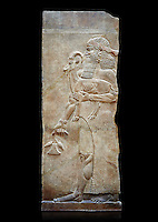 Stone relief sculptured panel of a man holding an Ibex and poppy seed pods. Facade N. Inv AO 19872 from Dur Sharrukin the palace of Assyrian king Sargon II at Khorsabad, 713-706 BC.  Louvre Museum Room 4 , Paris