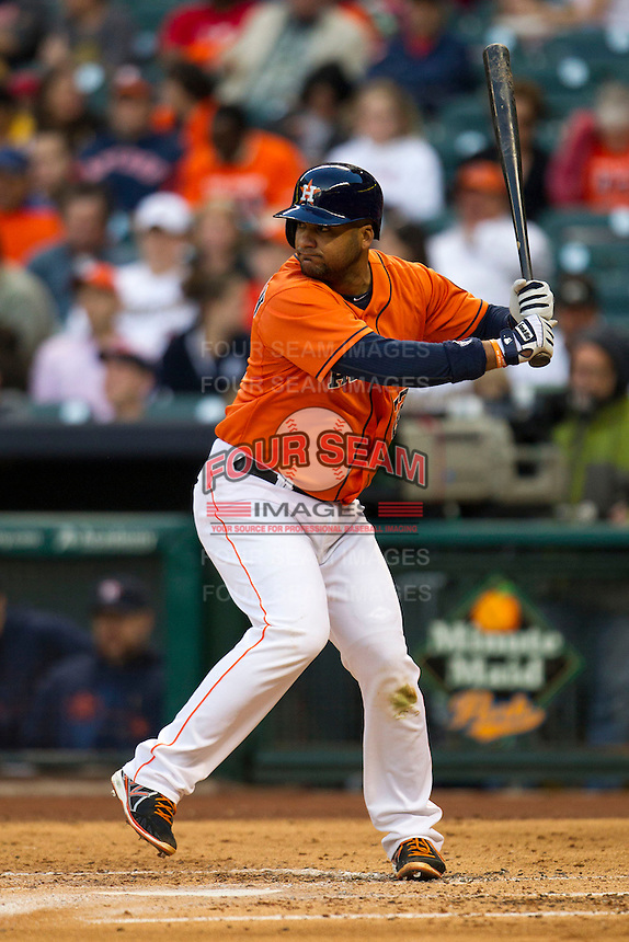 Houston Astros catcher Carlos Corporan (22) at bat during the MLB baseball game against the Detroit Tigers on May 3, 2013 at Minute Maid Park in Houston, Texas. Detroit defeated Houston 4-3. (Andrew Woolley/Four Seam Images).