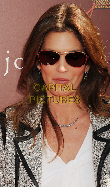 Cindy Crawford.9th Annual Stuart House Benefit held at John Varvatos Los Angeles, USA..11th March 2012.headshot portrait white jacket grey gray shirt sunglasses shades .CAP/ROT/TM.©Tony Michaels/Roth Stock/Capital Pictures