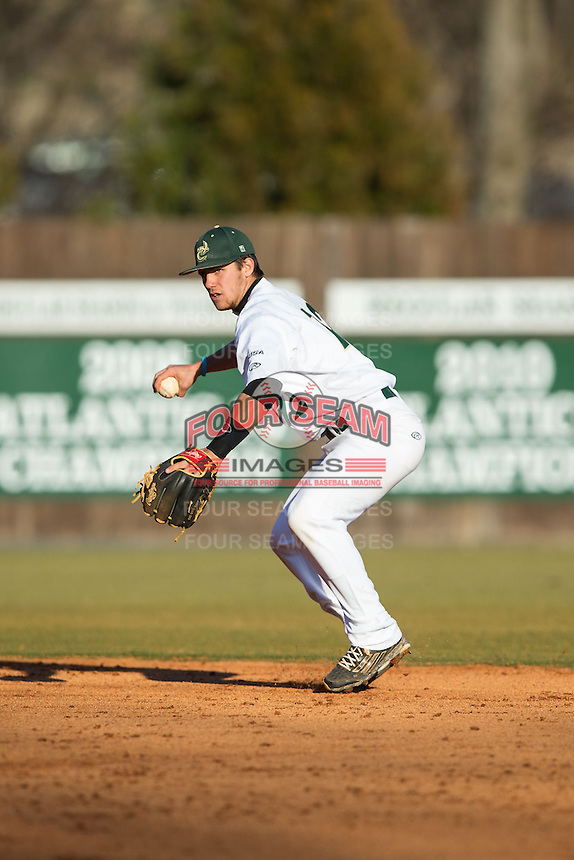 Charlotte 49ers shortstop Luke Gibbs (12) makes a throw to first base against the Rice Owls at Hayes Stadium on March 6, 2015 in Charlotte, North Carolina.  The Owls defeated the 49ers 4-2.  (Brian Westerholt/Four Seam Images)