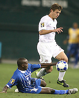 Robbie Rogers #7 of the USA tries to avoid a sliding tackle fom Osman Chavez #2 of Honduras during a CONCACAF Gold Cup match at RFK Stadium on July 8 2009 in Washington D.C. USA won 2-0.