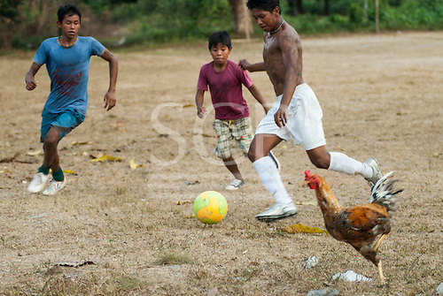 Aldeia Baú, Para State, Brazil. Football game and chicken run.