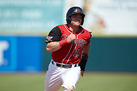 Matt Whatley (19) of the Hickory Crawdads hustles towards third base during the game against the Greensboro Grasshoppers at L.P. Frans Stadium on May 26, 2019 in Hickory, North Carolina. The Crawdads defeated the Grasshoppers 10-8. (Brian Westerholt/Four Seam Images)