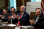 United States President Donald J. Trump (C) and members of the government applaud during a Cabinet Meeting at the White House in Washington, DC on October 21, 2019. Pictured from left to right: Administrator of the US Environmental Protection Agency Andrew Wheeler, US Secretary of Health and Human Services (HHS) Alex Azar, The President, and US Secretary of State Mike Pompeo.<br /> Credit: Yuri Gripas / Pool via CNP