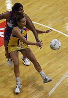 Vilimaina Davu tries to intercept a pass to Pulse goalshoot Jamilah Gupwell during the ANZ Netball Championship match between the Central Pulse and Northern Mystics, TSB Bank Arena, Wellington, New Zealand on Monday, 4 May 2009. Photo: Dave Lintott / lintottphoto.co.nz