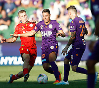 11th January 2020; HBF Park, Perth, Western Australia, Australia; A League Football, Perth Glory versus Adelaide United; Christopher Ikonomidis of the Perth Glory controls the ball as Ryan Strain of Adelaide United comes in to challenge - Editorial Use