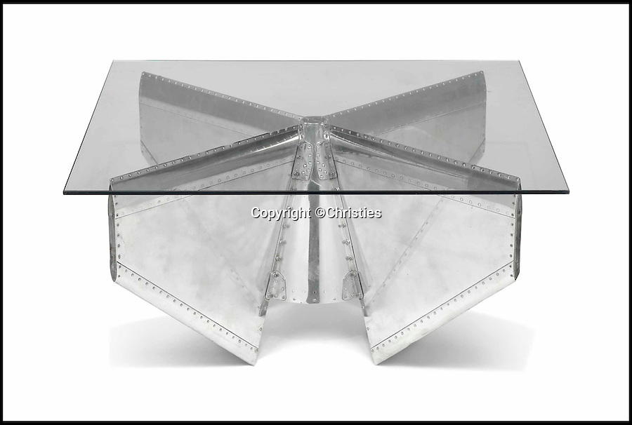 BNPS.co.uk (01202 558833)<br /> Pic: Christies/BNPS<br /> <br /> ***Please Use Full Byline***<br /> <br /> A polished aluminium and glass 'missile tail fin' low table. Est: £1500.<br /> <br /> Cold war hardware turning into hot property...<br /> <br /> Cold war collectables - Up market auction house Christie's has spotted a trend for cold war technology as high tech feature furniture for the modern collector.<br /> <br /> The Kensington auctioneers, normally associated with marble sculptures and Old Masters, are selling a collection of items as eclectic and diverse as a highly polished nose cone from a french Mirage jet, the ejector seat from a supersonic British Lightning and the tail fin from a missile.<br /> <br /> Anna said 'The aeronautic objects are interesting pieces of history as well dynamic items which make high-impact displays. There are increasing numbers of people with a passion for aviation looking for these bold, sculptural pieces of history.'<br /> <br /> Christies's - 17th Feb - London.