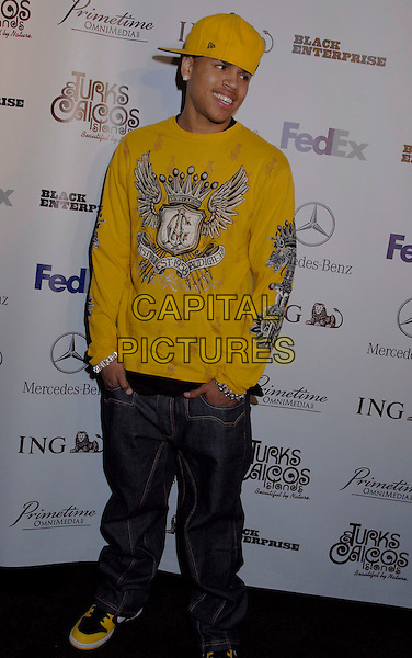 CHRIS BROWN.Black Enterprise Top 50 Hollywood Power Brokers List Party held at the Beverly Wilshire Four Seasons, Beverly Hills, California, USA, 21 February 2007..full length yellow cap hat top t-shirt.CAP/ADM/GB.©Gary Boas/AdMedia/Capital Pictures.