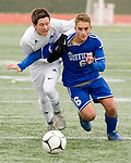 NEW BRITAIN, CT-111817JS14- Lewis Mills' Carter Viets (3) Suffield's  David Swan(6) get tangled up while fighting for the ball during their Class M state final game Saturday at Willow Brook Park in New Britain.<br /> Jim Shannon Republican-American