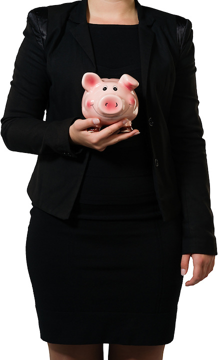 Female executive showing a coin box as a metaphor for savings or as a metaphor for a modern farmer or a financial manager