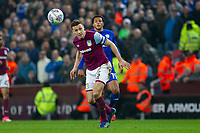 James Chester of Aston Villa heads clear of Nathaniel Mendez-Laing of Cardiff City during the Sky Bet Championship match between Aston Villa and Cardiff City at Villa Park, Birmingham, England on 10 April 2018. Photo by Mark  Hawkins / PRiME Media Images.