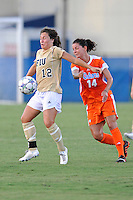 21 August 2011:  FIU's Kelly Ann Hutchinson (12) battles Florida's Jo Dragotta (14) for the ball in the first half as the University of Florida Gators defeated the FIU Golden Panthers, 2-0, at University Park Stadium in Miami, Florida.
