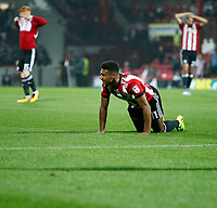 Ollie Watkins of Brentford and team mates are frustrated during the Sky Bet Championship match between Brentford and Derby County at Griffin Park, London, England on 26 September 2017. Photo by Carlton Myrie / PRiME Media Images.