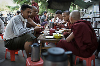 A group a monks talking with friends at a tea house in Mandalay. Meeting in groups like this is becoming increasingly difficult for monks since the junta's crackdown following the 2007 anti-government protests, which became known as the Saffron Revolution......