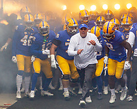 The PItt Panthers football team, lead by Head Coach Pat Narduzzi (in white) takes the field. The Pitt Panthers defeated the Virginia Tech Hokies 52-22 on November 10, 2018 at Heinz Field in Pittsburgh, Pennsylvania.