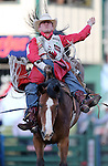 Jared Smith competes in the bareback bronc riding event at the Reno Rodeo in Reno, Nev. on Friday, June 19, 2015.<br /> Photo by Cathleen Allison/Nevada Photo Source
