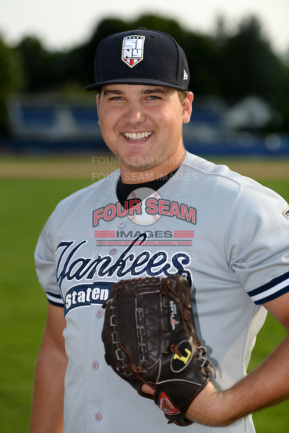 Staten Island Yankees pitcher Sean Carley (61) poses for a photo before a game against the Batavia Muckdogs on August 8, 2014 at Dwyer Stadium in Batavia, New York.  Staten Island defeated Batavia 4-2.  (Mike Janes/Four Seam Images)