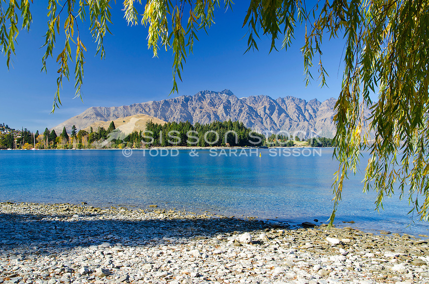 The Remarkables and Queenstown Gardens from the shores of Lake Wakatipu, Queenstown, South Island, New Zealand