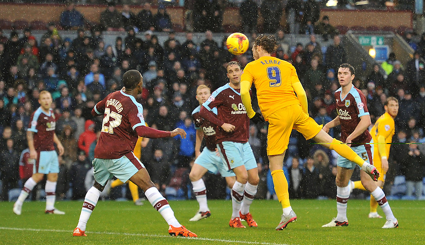 Preston North End's Will Keane gets to the ball first as his brother, Burnley's Michael Keane (right) can only watch<br /> <br /> Photographer Dave Howarth/CameraSport<br /> <br /> Football - The Football League Sky Bet Championship - Burnley v Preston North End - Saturday 5th December 2015 - Turf Moor - Burnley<br /> <br /> &copy; CameraSport - 43 Linden Ave. Countesthorpe. Leicester. England. LE8 5PG - Tel: +44 (0) 116 277 4147 - admin@camerasport.com - www.camerasport.com