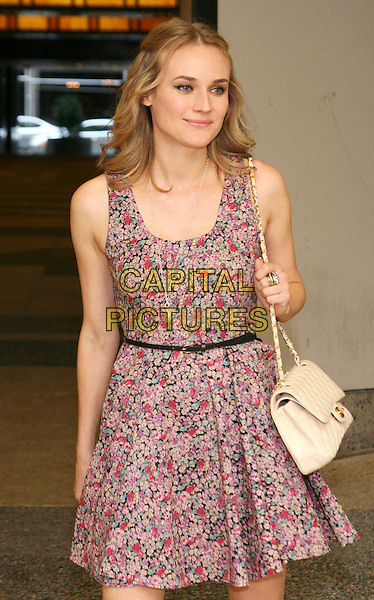 DIANE KRUGER.Celebrity sighting outside MTV Studios, New York, NY, USA, .August 17th 2009..half length red and pink print floral dress  cream Chanel bag chain strap .CAP/LNC/TOM.©LNC/Capital Pictures.
