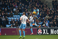 Marcus Bean of Wycombe Wanderers beats Kyel Reid of Coventry City to the ball during the The Checkatrade Trophy - EFL Trophy Semi Final match between Coventry City and Wycombe Wanderers at the Ricoh Arena, Coventry, England on 7 February 2017. Photo by Andy Rowland.